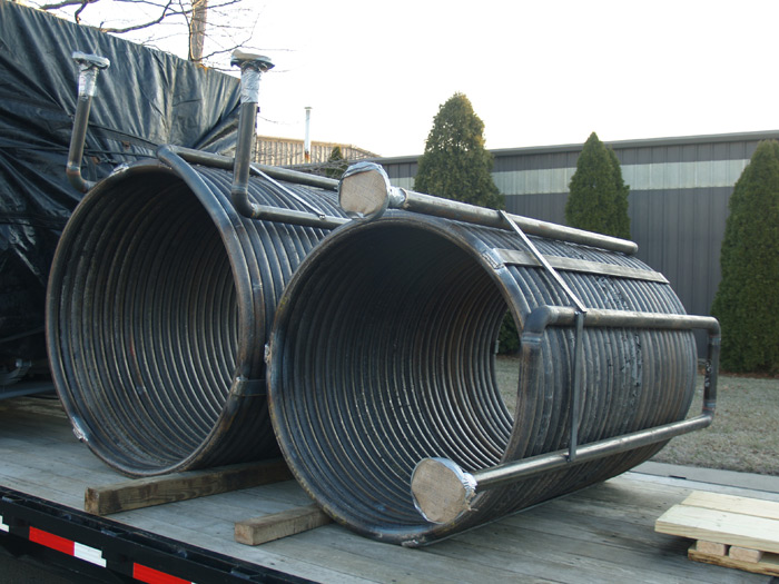 Two Helical Coils with Flanges and Supports
